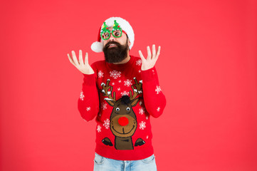 Hipster bearded man wear winter sweater and hat. New year. Knitted sweater. Happy new year....