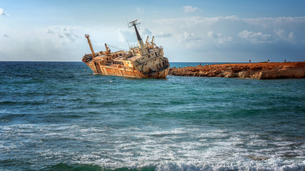 Fotobehang Schipbreuk Cyprus, Paphos. Shipwreck. The ship crashed on the coastal rocks. Rusty ship at the shore of the Mediterranean sea. Tourist attractions of Cyprus.