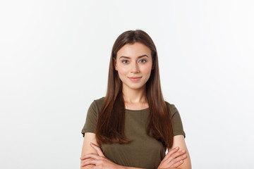 Portrait of a beautiful young woman looking at the camera and smiling, isolated on a white background.