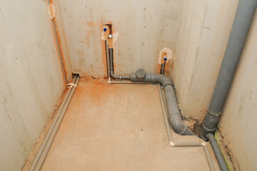 Domestic plumbing and sewage pipes connections in house construction.