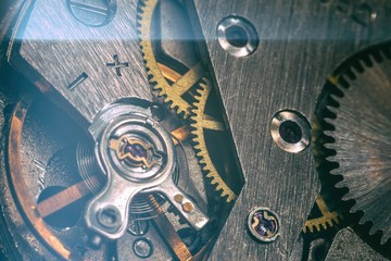 Deurstickers Macrofotografie vintage old mechanism with gears and springs, clock mechanism close-up macro
