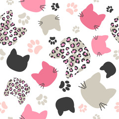 Seamless vector pattern with cats heads and leopard print for kids