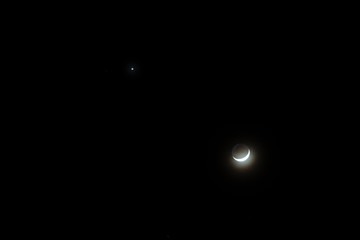 Crescent moon and star during the night time