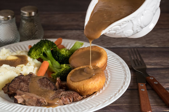 Plate of Roast beef and gravy.