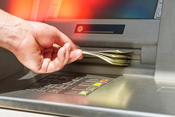 Atm bank banking paper currency bank teller removing currency