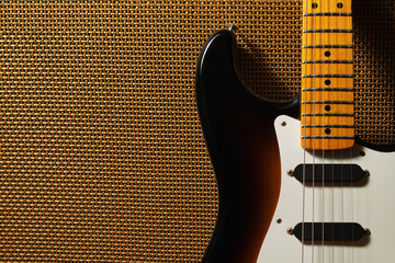 Electric guitar and amplifier grill in stage lighting