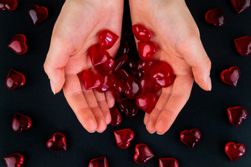 Figurines heart in hands as a symbol of love