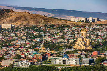 Fototapete - cityscape skyline of Tbilisi with Presidential palace and Holy Trinity Cathedral Georgia capital city eastern Europe