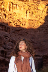 A woman wondering at sunset in a rocky desert