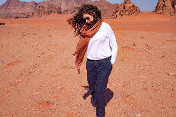 Woman posing in the desert with a scarf