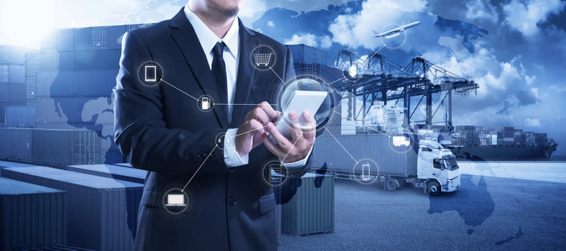 Businessman touching smartphone for analyze stock at logistics port