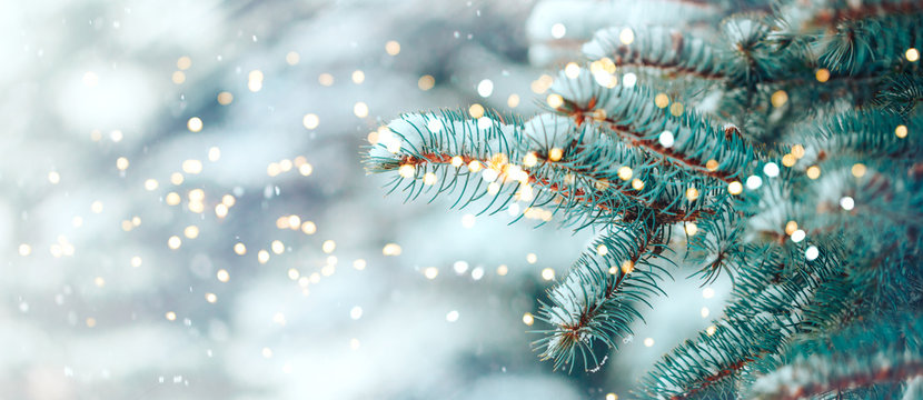 Christmas tree outdoor with snow, lights bokeh around, and snow falling, Christmas atmosphere.