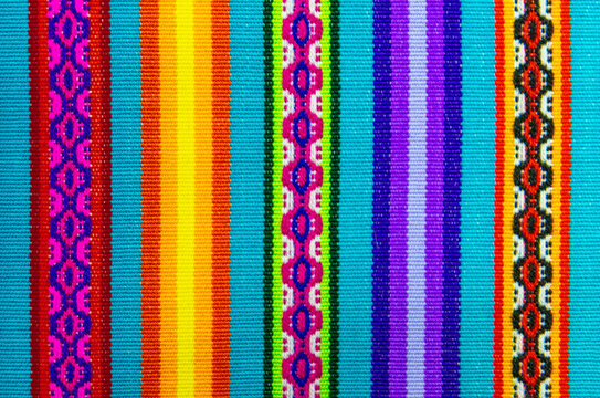 Vibrant colors of a traditional Andes textile on the local art and craft market of Cusco, Peru. These textiles can be found in the Andes countries of Bolivia, Ecuador and Peru.