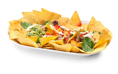 Plate with tasty chili con carne, guacamole and nachos on white background