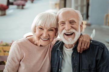Joyful nice couple being in a great mood