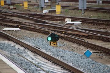 Green sign light between railroad tracks at Amersfoort station