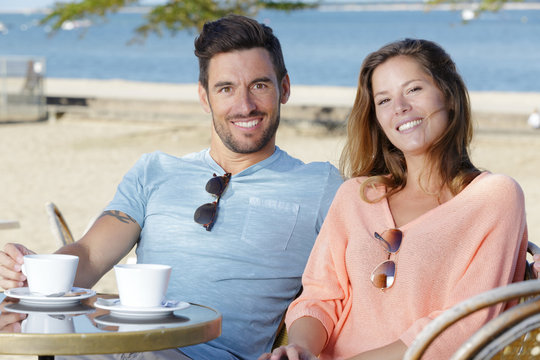 couple at a cafe by the beach
