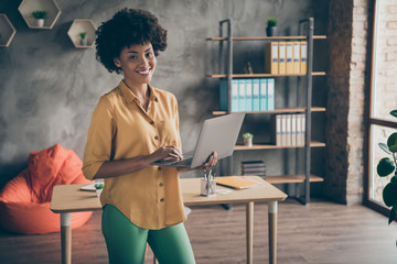 Portrait of cool afro american girl start-up entrepreneur hold computer leadership watch work...