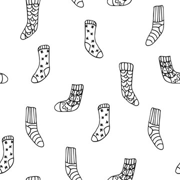 Vector seamless pattern with cute hygge socks on white background. Great print  for fabric, wrapping papers, wallpapers, fabric, cover. Doodle style illustration in black ink, outline.
