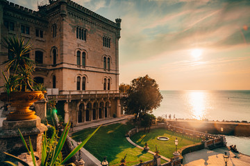 Poster Mediterraans Europa Dramatic view of the tourist spot Castello di Miamare (Castle of Miramare) in Trieste, Italy on the Mediterranean sea coast in europe while sunset.