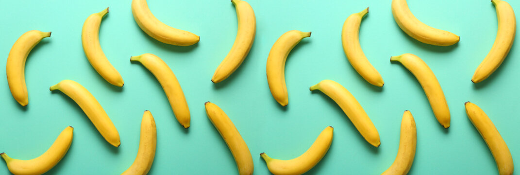 Many sweet ripe bananas on color background