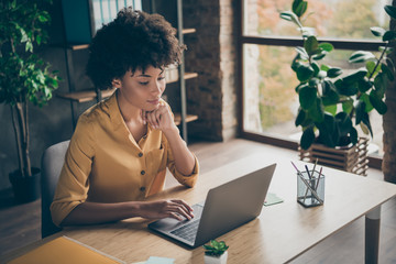 Photo of confident interested thinking mixed-race woman guessing how to fix issues in yellow shirt reports to send them to entrepreneur for being checked out Wall mural