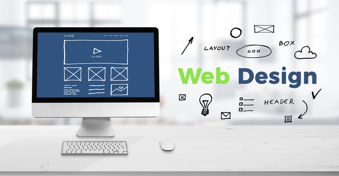 Web design studio concept with computer display on work desk and web design text surrounded with sketch web page elements.