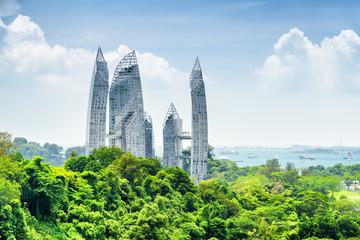 Cityscape in Singapore. Amazing skyscrapers among green trees