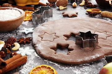 Baking christmas cookies. Typical cinnamon stars bakery with spices. xmas decoration on table