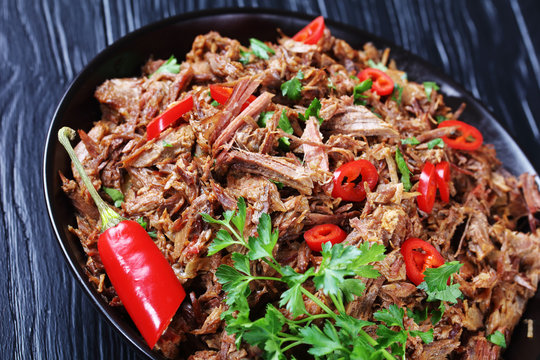 close-up of spicy pulled beef in a bowl
