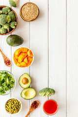 Healthy food. Vegatables and fruits on white wooden background top view frame copy space