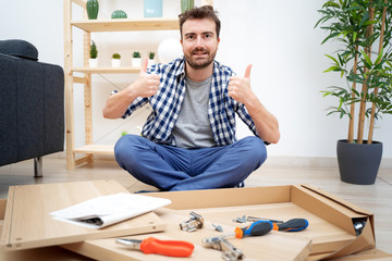 Man portrait and do it yourself furniture assembly