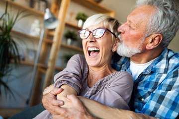 Cheerful senior couple enjoying life and spending time together