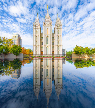Classic panoramic view of famous Salt Lake Temple of The Church of Jesus Christ of Latter-day Saints on Temple Square with beautiful reflections on a sunny day in autumn, Salt Lake City, Utah, USA