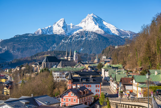 Classic panoramic view of historic old town of Berchtesgaden with famous snow-capped Watzmann mountain top on a beautiful sunny day in early spring, Berchtesgadener Land, Upper Bavaria, Germany