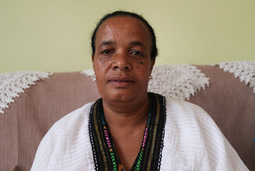 Yerusalem Kawiso, 48, a government employee who lost a brother, a brother in law and a great uncle to Sidama struggle, makes coffee in her house after voting for the Sidama autonomy during the referendum vote in Hawassa