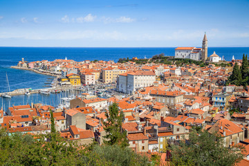 Poster Mediterraans Europa Beautiful aerial view of historic city center of ancient Piran with famous Church of Saint George and Tartini Square on a sunny day with blue sky and clouds in summer, Gulf of Prian, Istria, Slovenia