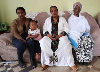 Yerusalem Kawiso, a government employee who lost a brother, brother in law and a great uncle to Sidama struggle sits inside her house in Hawassa