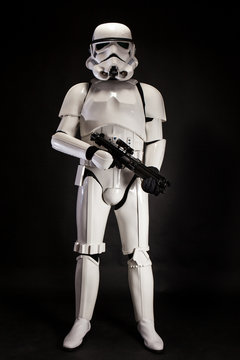 SAN BENEDETTO DEL TRONTO, ITALY. NOVEMBER 11, 2017. Studio portrait  of stormtrooper costume replica, with blaster E-11 gun. He is a fictional character of Star Wars saga. Black background
