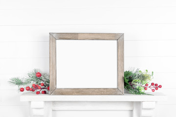 Rough wooden frame on a light background with branches of greenery