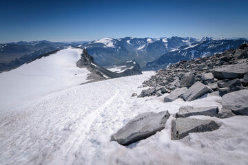 Snow tracks up and down the Galdhopiggen mountain in Jotunheimen Norway