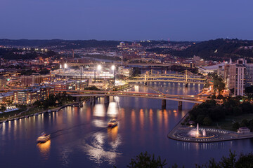 Cityscape of Pittsburgh and Evening Light. Blurry Ferries because of Long Exposure.