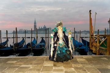 Foto op Aluminium Gondolas Carnival in Venice and gondolas on grand canal