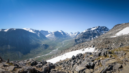 Panorama of Jotunheimen mountain valley with clear blue sky Norway