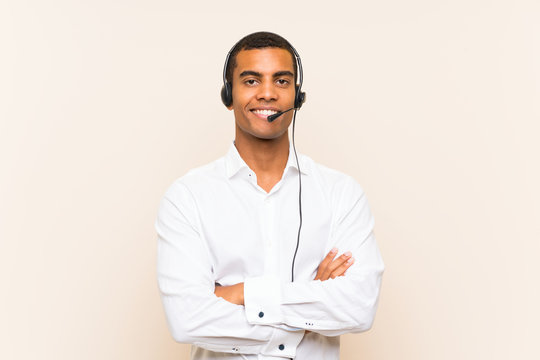 Young brunette man working with a headset smiling a lot