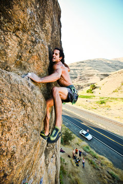 Adrian Daigle climbs Hand Over Hand 5.11a at Granite Point, a small climbing area along the Snake River in southeast Washington.