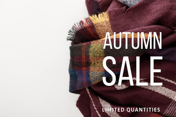 top view of burgundy wool plaid scarf on white background with autumn sale illustration Wall mural