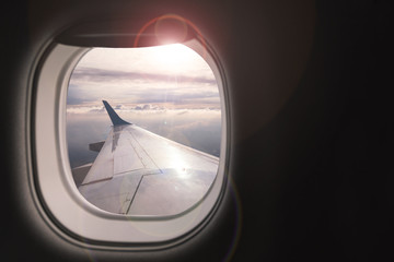 Airplane wing with beautiful sky from airplane window