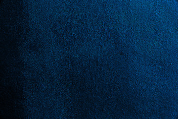 Abstract textured background in dark blue