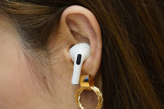BANGKOK,THAILAND-NOVEMBER 20: Close-up on The New Apple Airpods Pro Woman Ear on November 20,2019